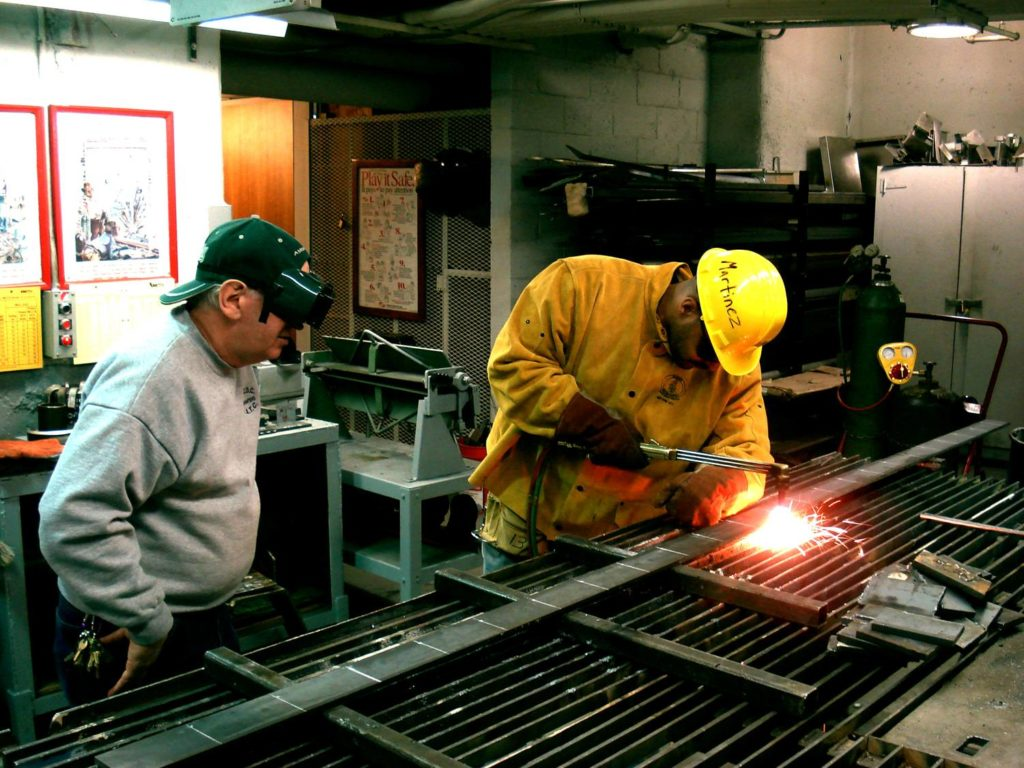 Job seekers learn to weld through a program supported by the NYC Workforce Funders