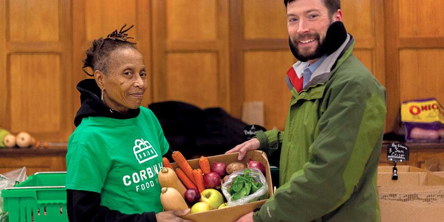 Volunteers work with a healthy food box program.