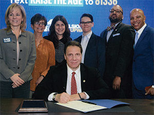 Gov. Andrew Cuomo signed Raise the Age into law