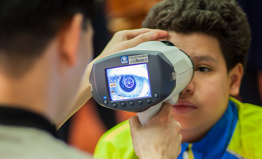 Brooklyn student gets his eyes checked.