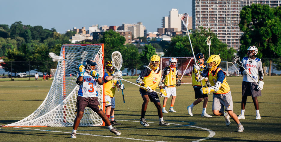Students in Harlem playing lacrosse.
