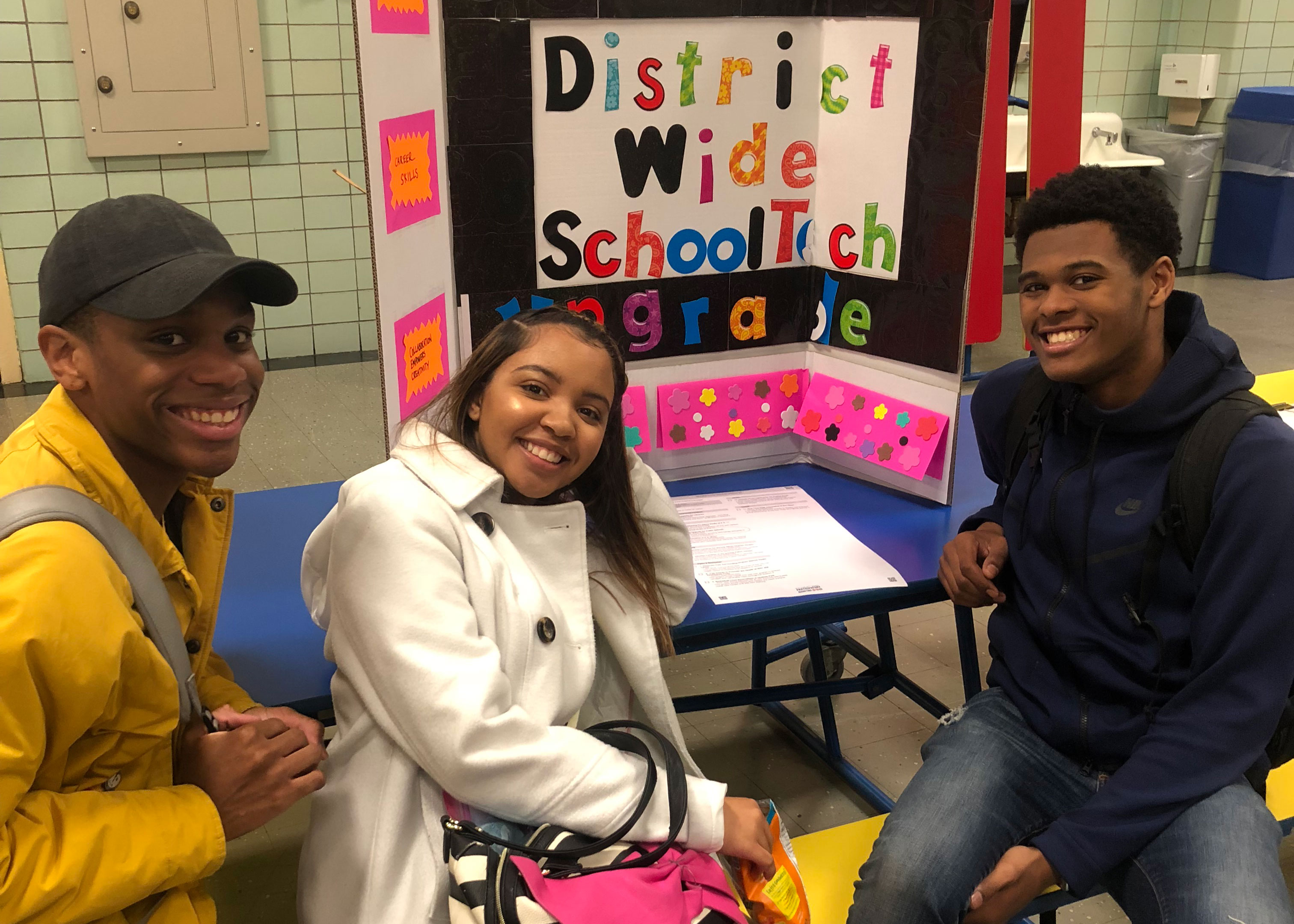 Three students at a Participatory Budgeting Expo.