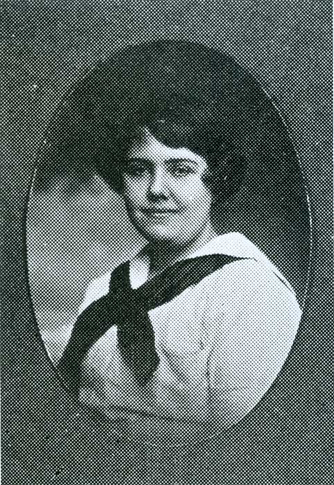 Albertina wearing a white sailor style top and a black ascot.