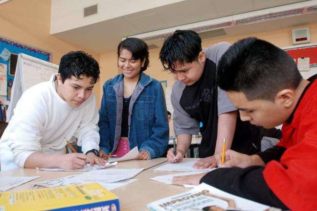 Students learn together at an Internationals Network school