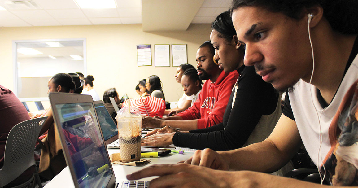 adult learners in computer class