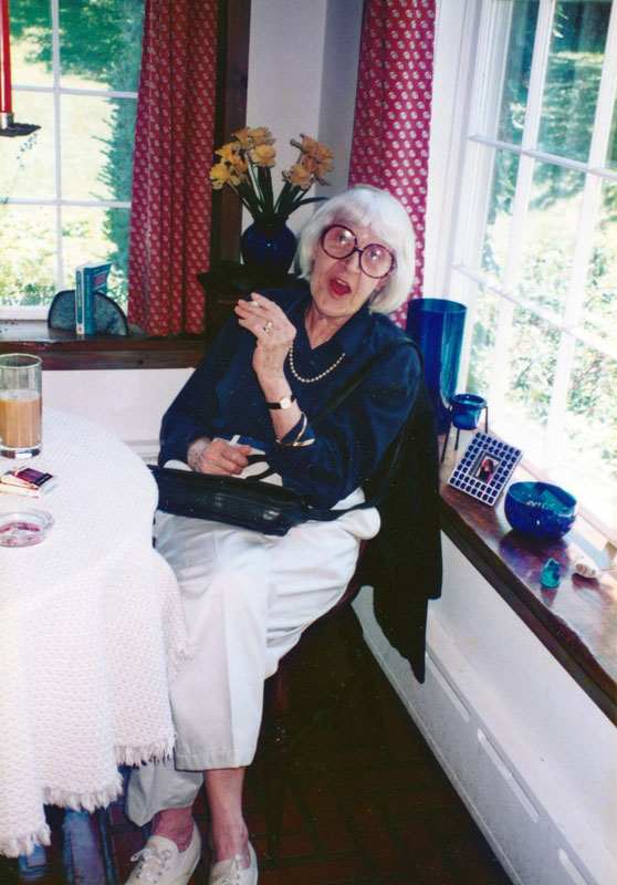 Helen Merrill sitting in the kitchen of good friend and client Christopher Durang.