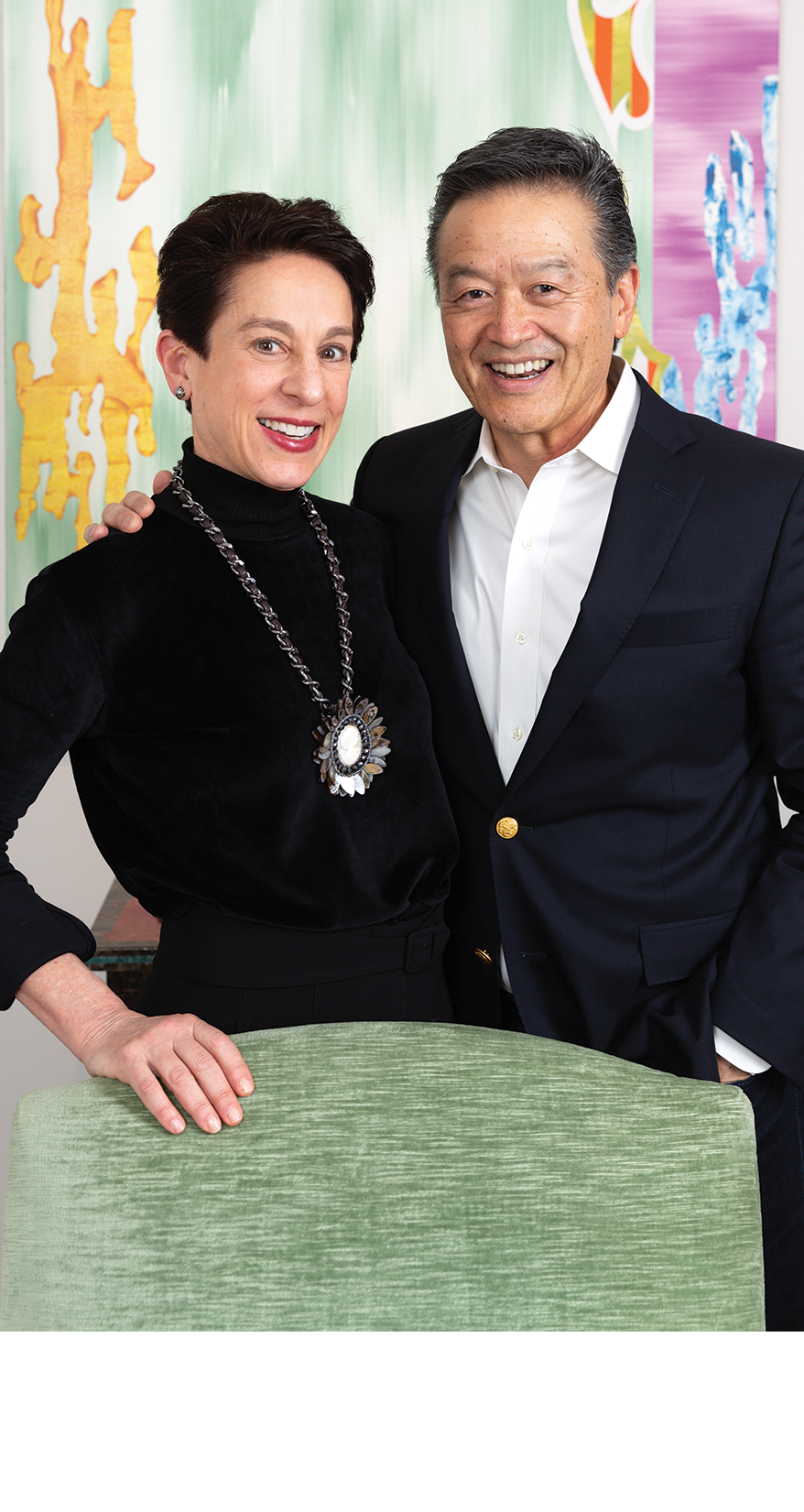 Melinda Wolfe and Ken Inadomi standing next to each other in front of a painting